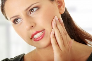 Grinding teeth can cause aching in the jaw and head.